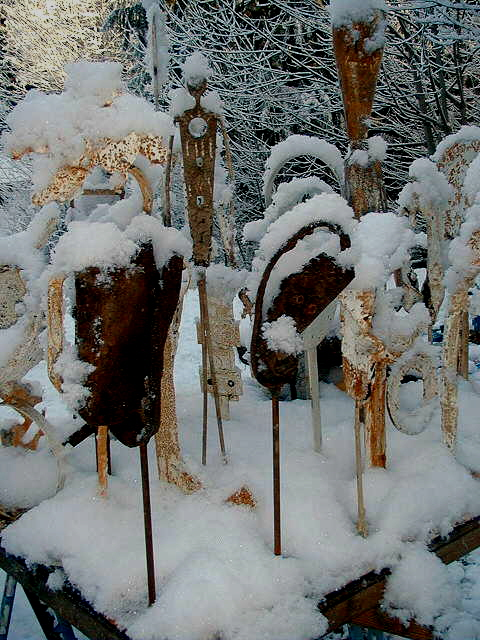 metal figures in snow